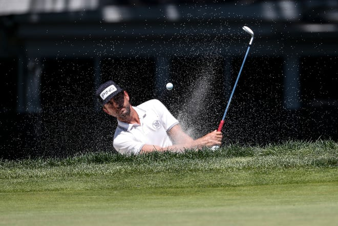 Scott Harrington, hitting out of a bunker at last year's Rocket Mortage Classic, is making his Players Championship debut this week at the age of 40.