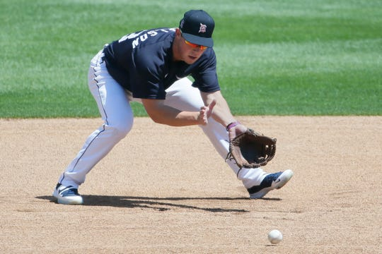 Spencer Torkelson fields a ground ball during practice on Saturday at Comerica Park.