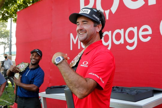Bubba Watson and Harold Varner III show off the winners' belts after their nine-hole exhibition against Jason Day and Wesley Bryan ahead of the Rocket Mortgage Classic on Wednesday.