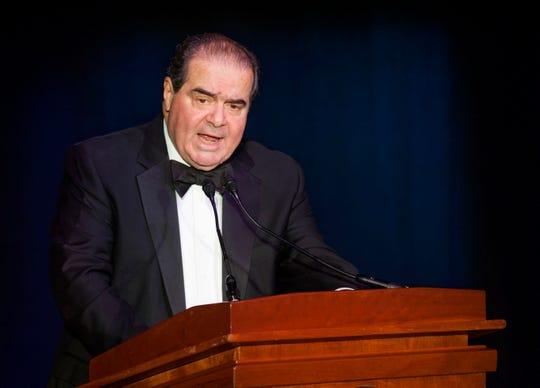In this Nov. 6, 2014, file photo Supreme Court Justice Antonin Scalia speaks in Washington.