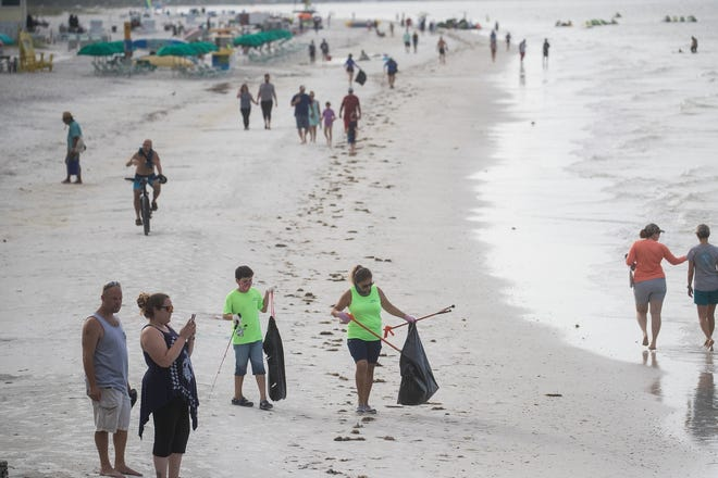 Volunteers with Keep Lee County Beautiful cleaned up Fort Myers Beach near the pier on July 5, 2020. According to Mike Thomas, program coordinator, about 30 volunteers picked up about 250 pounds of trash after the Fourth of July holiday. Some of the items picked up were cigarette butts, cardboard fireworks boxes, bottle caps and more. Thomas said it was a lot less than last year, when they collected 1,000 pounds.