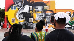 Family members of Breonna Taylor attended the unveiling of a mural on West Main Street that prominently depicts her and other African Americans who have died at the hands of law enforcement on July 5, 2020.