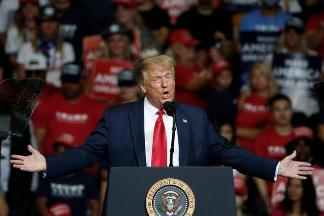 President Donald Trump speaks during a campaign rally in Tulsa, Okla., on June 20. Face masks and adequate social distancing will be required if the president wants to hold a rally in Arkansas, Gov. Asa Hutchinson said Sunday.
