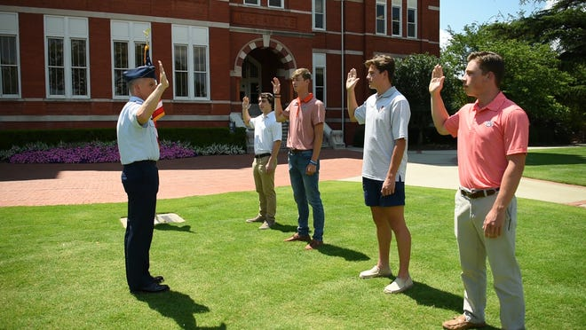 Major Shawn Daley, 187th Fighter Wing intelligence officer, officiateS swearing in four new members to Alabama Air National Guard's 187th FW and 117th Air Refueling Wing June 19, 2020 in front of Samford Hall at Auburn University.