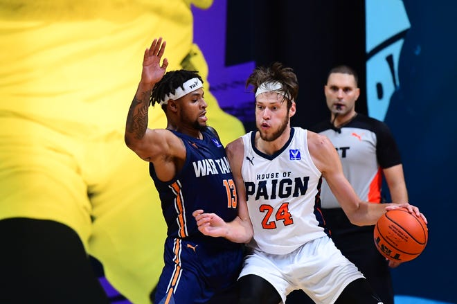 Mike Daum dribbles toward the basket for House of 'Paign during a The Basketball Tournament game in 2020. The 2021 version of the team was upset in the first round Saturday at Carver Arena in Peoria.