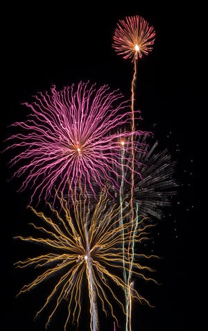 The Scottsdale firework show is seen from a sold-out WestWorld parking lot on July 4, 2020.