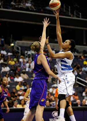 Chasity Melvin, right, is joining the Phoenix Mercury as an assistant coach. She is shown playing against the Mercury in 2010.