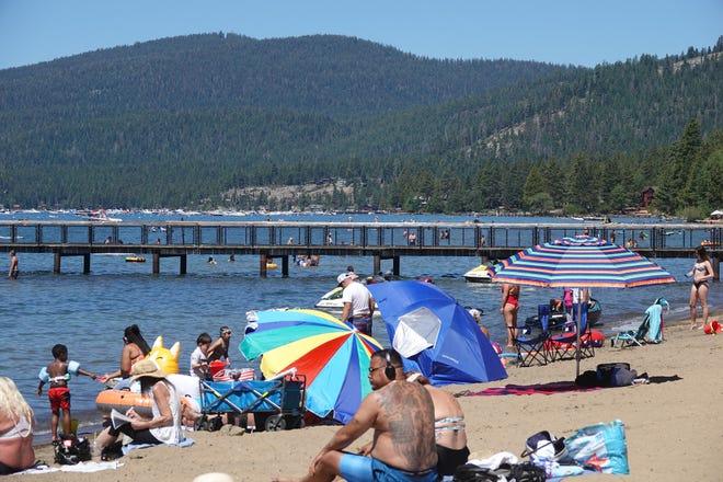 Crowds pack Kings Beach at Lake Tahoe on July 5, 2020.