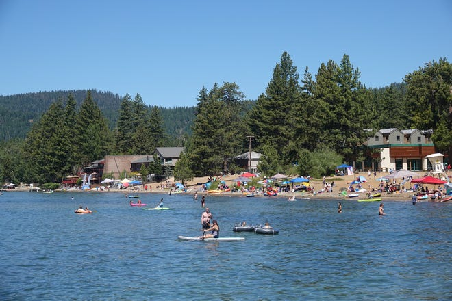 A crowd of people are seen visiting Kings Beach on July 5, 2020.
