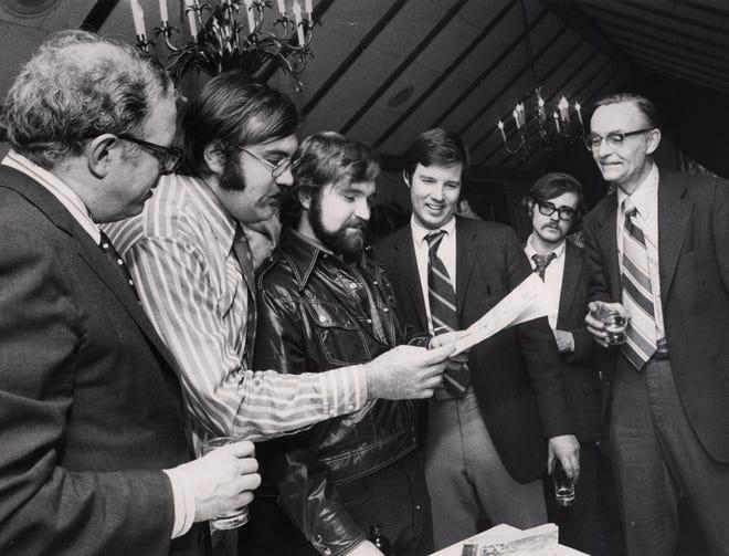 Times-Union celebrates winning the Pulitzer Prize. Left to right, Stu Dunham, Jack Garner, Dick Cooper, John Machacek, unidentifed person, John Dougherty