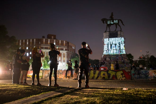 Richmond residents spent the night listening to music, eating food and watching projections on the Robert E. Lee Monument on Saturday, July 4, 2020, in Richmond, Virginia. Protesters renamed the area the Marcus-David Peters Circle, after the Black man killed by police during an interaction while Peters was experiencing a mental health issue.