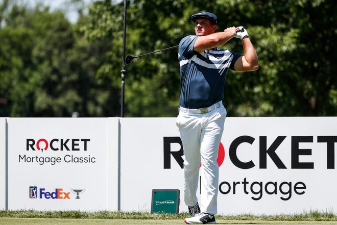 Bryson DeChambeau tees off on the second hole during the final round of the Rocket Mortgage Classic at the Detroit Golf Club.
