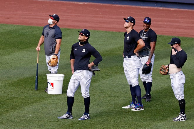 Yankees outfielders Giancarlo Stanton, Aaron Judge, Aaron Hicks and Clint Frazier work over the weekend. Delay coronavirus test results caused other MLB teams to cancel their workouts Monday. ADAM HUNGER/AP