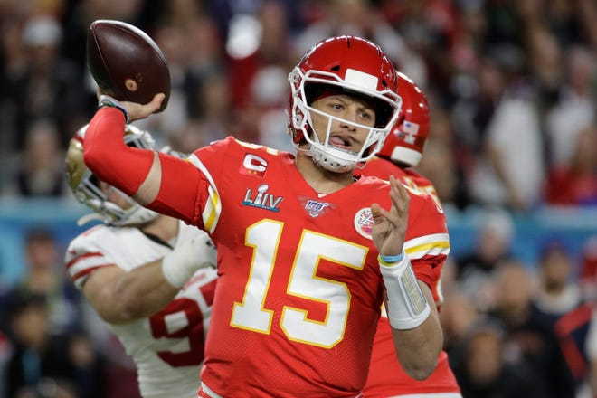 The Chiefs have agreed to a 10-year contract extension with Super Bowl MVP Patrick Mahomes keeping him around through 2031. ESPN.com reported the deal is worth $450 million with an injury guarantee of $140 million. PATRICK SEMANSKY/AP