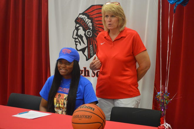 Tioga coach Debbie Johnson (standing) says a few words about Lady Indians senior Alayah Robertson Monday. Robertson signed with Louisiana College.