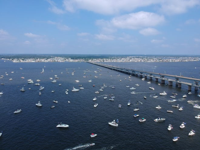 Boats gather to show their support for President Donald Trump and law enforcement, before starting a boat parade across Barnegat Bay.