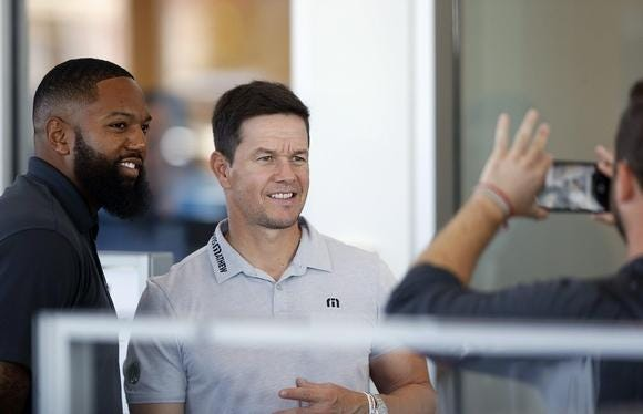 Mark Wahlberg poses for a photo with Justin Luckett at Mark Wahlberg Chevrolet in Columbus in 2018.