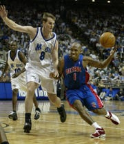 Pistons' Chauncey Billups loses the basketball under pressure from Magic defender Pat Garrity during their playoff game in Orlando, April 27, 2003.