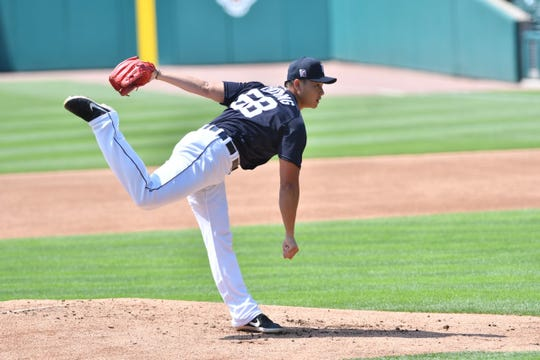 Shao-Ching Chiang pitches at Comerica Park on Monday during the Tigers' Summer Camp workout.