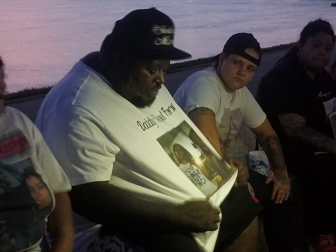 Kareem Strother shows the crowd his T-shirt, which has a photo of his daughter Mariah Strother on it, at a prayer vigil Sunday evening, July 5, 2020. Mariah was killed in a shooting on May 30.