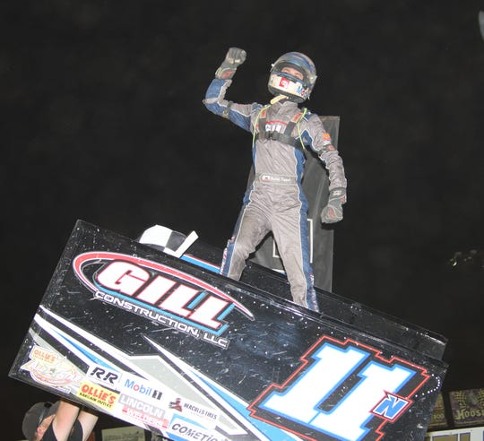 Buddy Kofoid celebrates in victory lane at Fremont after winning on the second night of Ohio Speedweek.