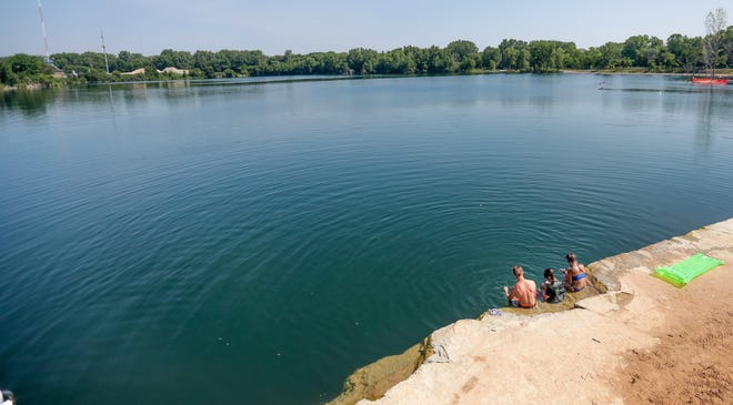 Children dive and explore the Duck Creek Quarry on Monday, July 6, 2020, in Howard, Wis. The quarry is open to village residents. A wristband is needed to enter and can be picked up at the village hall.