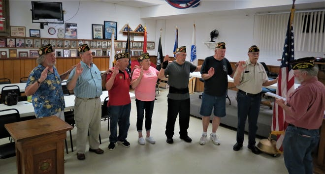 VFW Post 3246 recently swore in new officers. Those taking the oath include, from left, Ric Bondy, George Wolford, Pat Parker, Rose Mulholland, David Brantly, Mike Mullin, and Commander Charley Wensel. Administering the oath at far right is District 2 Commander Bill Nolan. The VFW Post 3246 is now open located at 214 West 7th Street just west of Fire House #1 at Gray Street . For more information call ( 870) 425-6174.
