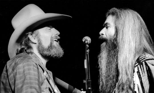 """Country music stars Charlie Daniels, left, and William Lee Golden combined their talents on a stirring rendition of """"How Great Thou Art,"""" accompanied by Bobby Jones and New Life to the delight of the large crowd in attendance at Entertainment Expo '82's opening night show Nov. 12, 1982."""