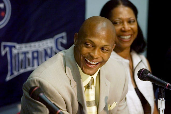 Eddie George and his mother, Donna, were all smiles after the running back announces his signing a 6-year, $42 million contract extension with the Tennessee Titans at a press conference at the team headquarters July 18, 2000.
