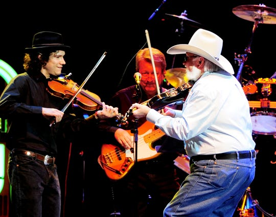 """Charlie Daniels, right, plays """"Me and Jesus"""" at the 'Playin' Possum: The Final No Show"""" at the Bridgestone Arena Nov. 22, 2013."""