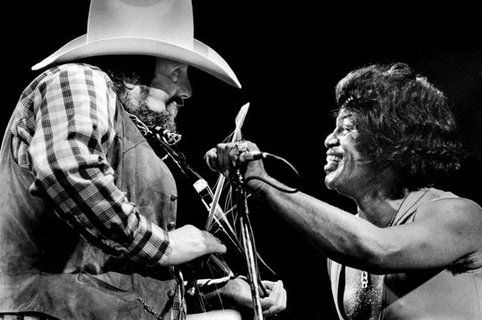 Host Charlie Daniels, left, match the intensely energetic performance of James Brown during the ninth annual Volunteer Jam nine-hour marathon concert at the Municipal Auditorium Jan. 22, 1983.
