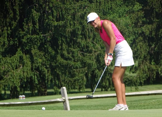 Granville sophomore Jaden Tripp putts on No. 9 on Monday during the Licking County Junior Golf Association match at Denison Golf Club.