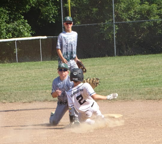 Coen Grandstaff slides safely into second for the Ohio Hitmen 12U against the Mid-Ohio Raptors on Sunday in the championship game of the Marlins Firecracker at the Athletics Baseball Moose Field. The Raptors won 8-5.