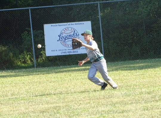 Center fielder Bodie Martin lines up to field a hit for the Mid-Ohio Raptors 12U before throwing out an Ohio Hitmen runner at the plate on Sunday in the championship game of the Marlins Firecracker at the Athletics Baseball Moose Field. The Raptors won 8-5.