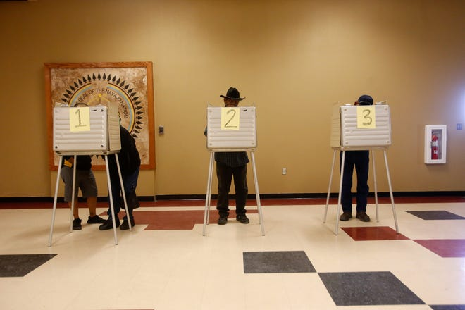 Voters fill out their ballots during the Navajo Nation general election on Nov. 8, 2016 at the Upper Fruitland Chapter house.