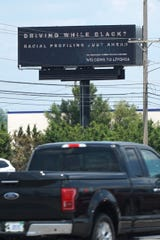 A sign warning of racial profiling as seen on Telegraph Road in Redford Township just south of Interstate 96.