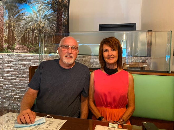 Jack Srebnik and Ellen Spencer are photographed at The Slice, their New York-style pizzeria in Rancho Mirage.