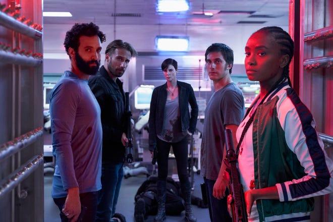 "Marwan Kenzari as Joe, Matthias Schoenaerts as Booker, Charlize Theron as Andy,  Luca Marinelli as Nicky, Kiki Layne as Nile in ""The Old Guard"" on Netflix."