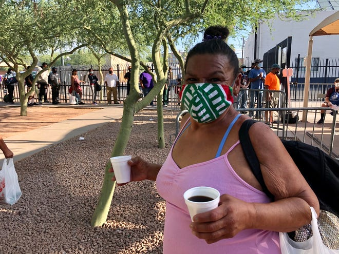 """""""Do I smell coffee or am I dreaming?"""" Michelle Thomas asks in line for breakfast at the Society of St. Vincent de Paul in Phoenix."""