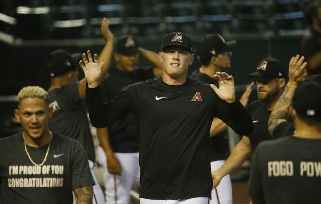 Diamondbacks Kevin Cron gives air high-fives with teammates during Diamondbacks Summer Camp 2020 in at Chase Field in Phoenix, Ariz. on July 5, 2020.
