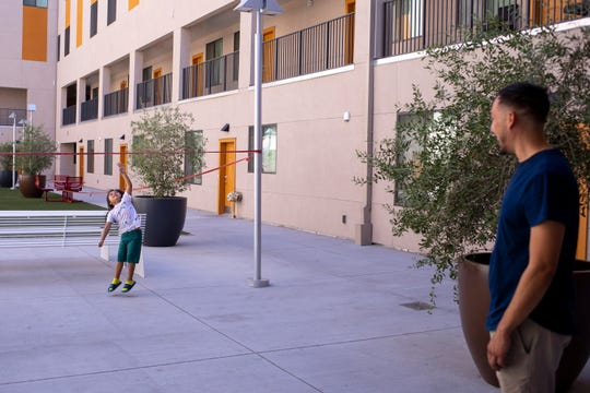 Reynaldo Galindo, 31, watches his son Royall, 4, on July 6, 2020, at Urban Living on Fillmore in downtown Phoenix. Galindo and his children were living with friends before finding a three bedroom apartment at the new affordable housing project.