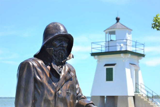 """""""The Lightkeeper"""" sculpture by former Port Clinton resident Andy Sacksteder is on display near the Lighthouse for the summer."""