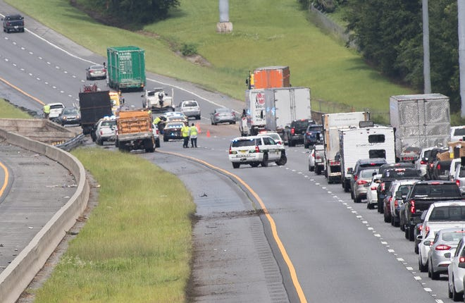 """Eastbound traffic on Interstate 10 slows to one lane as the Florida Highway Patrol and Leon County Sheriff's Office investigate """"several vehicle crashes between mile markers 199 and 203"""" Monday, July 6, 2020."""