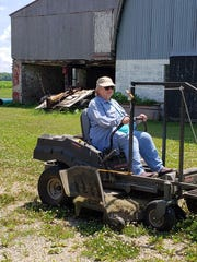 Susan mowing with Bob's zero-turn mower may give a viewer a start.
