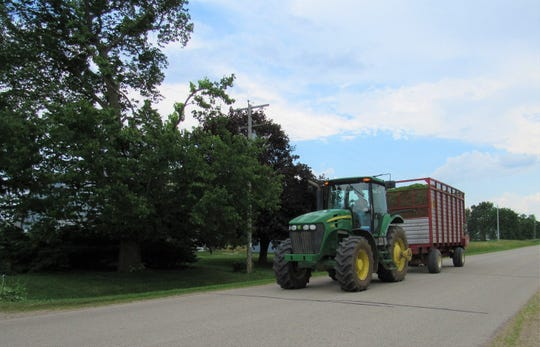 Blue sky means it's a good time to chop hay. Susan's a neighbors rush to beat popup showers.