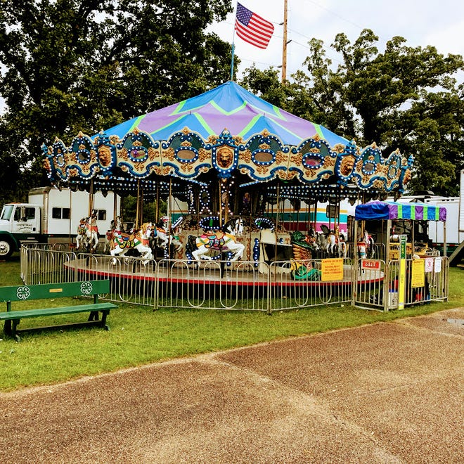 This merry-go-round awaits riders at the Waushara County Fair in 2019. This year, many beloved fair rides will remain in storage due to COVID-19.