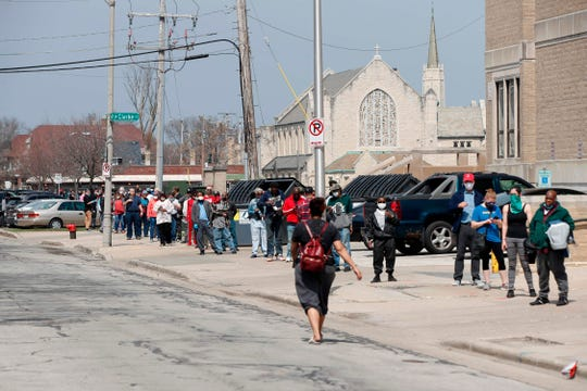 Milwaukee, Wis., residents wait in long line to vote in a presidential primary election outside the Riverside High School on April 7, 2020. Democratic officials had sought to postpone the election but were overruled by state Supreme Court, and the U.S. Supreme Court stepped in to bar an extension of voting by mail that would have allowed more people to cast ballots without going to polling stations.