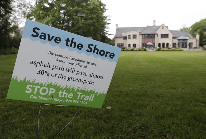 """""""Save the Shore"""" yard signs dot Lakeshore, North Park and East Wisconsin avenues in Neenah."""