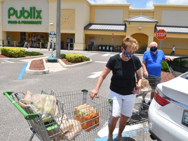 Satellite Beach residents Dodi and Chuck Nuese shop Tuesday at Publix at Atlantic Plaza in Satellite Beach. All of the senior citizens wore masks, but some younger shoppers did not, Chuck said.