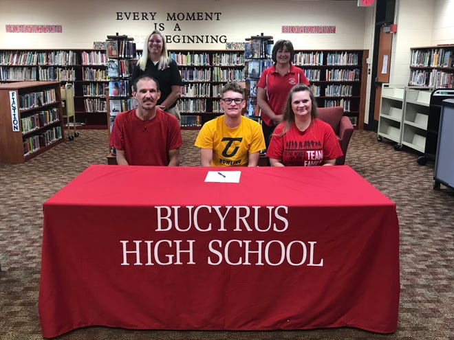 Tod Spurlock commits to Tiffin University for bowling surrounded by his parents, Tod Sr. and Carey Young. Athletic Director Kelli Williams and coach Diane Kaple stand behind.